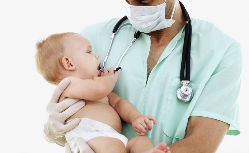 close-up of a male doctor carrying a baby boy