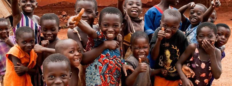 Kumasi, Ghana - July 21, 2007: African kids smiling a the camera in the  village of Kumasi .Ghana